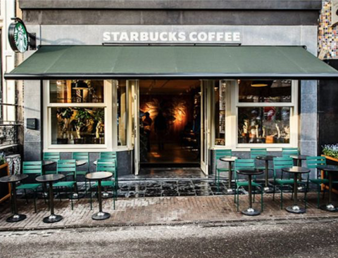 <p>Located in the Flower Market in Amsterdam, this is Starbucks storefront goals. Inspired by the traditional Dutch flower shops in the area, the inside is filled with vintage flower vases.</p>