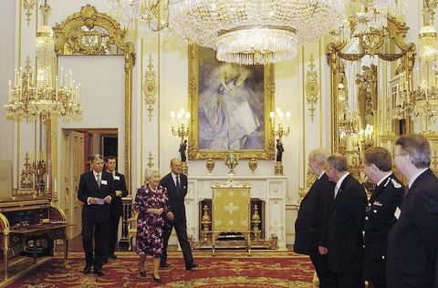 """<p>As soon as the Queen enters the room, everyone <a href=""""http://www.eonline.com/shows/the_royals/news/610777/8-things-you-should-never-do-when-meeting-the-royals"""" target=""""_blank"""" data-tracking-id=""""recirc-text-link"""">must stand to greet her</a> and should not sit down until she does. Only then is it polite to take a rest.<span class=""""redactor-invisible-space"""" data-verified=""""redactor"""" data-redactor-tag=""""span"""" data-redactor-class=""""redactor-invisible-space""""></span></p>"""