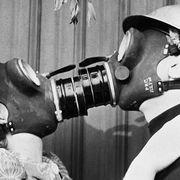 Couple Kissing Through Gas Masks