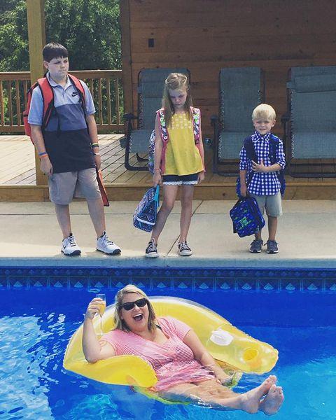 Fun, Swimming pool, Human body, Water, Leisure, Mammal, Summer, Shorts, Aqua, Luggage and bags,