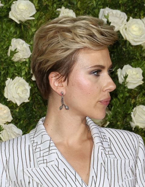 <p>Whoever said mullet styles are universally unflattering have never seen a great pixie cut with a *reverse mullet* (longer on top, super short in the back). Johansson's is a much more masculine take on the pixie that truly looks badass on her frame. </p>