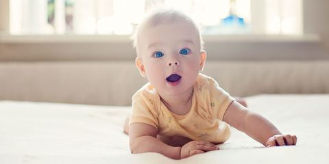 Child, Face, Facial expression, Baby, Skin, Toddler, Head, Nose, Cheek, Tummy time,