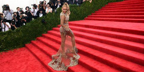 Red carpet, Carpet, Red, Flooring, Dress, Event, Grass, Formal wear, Gown, Plant,