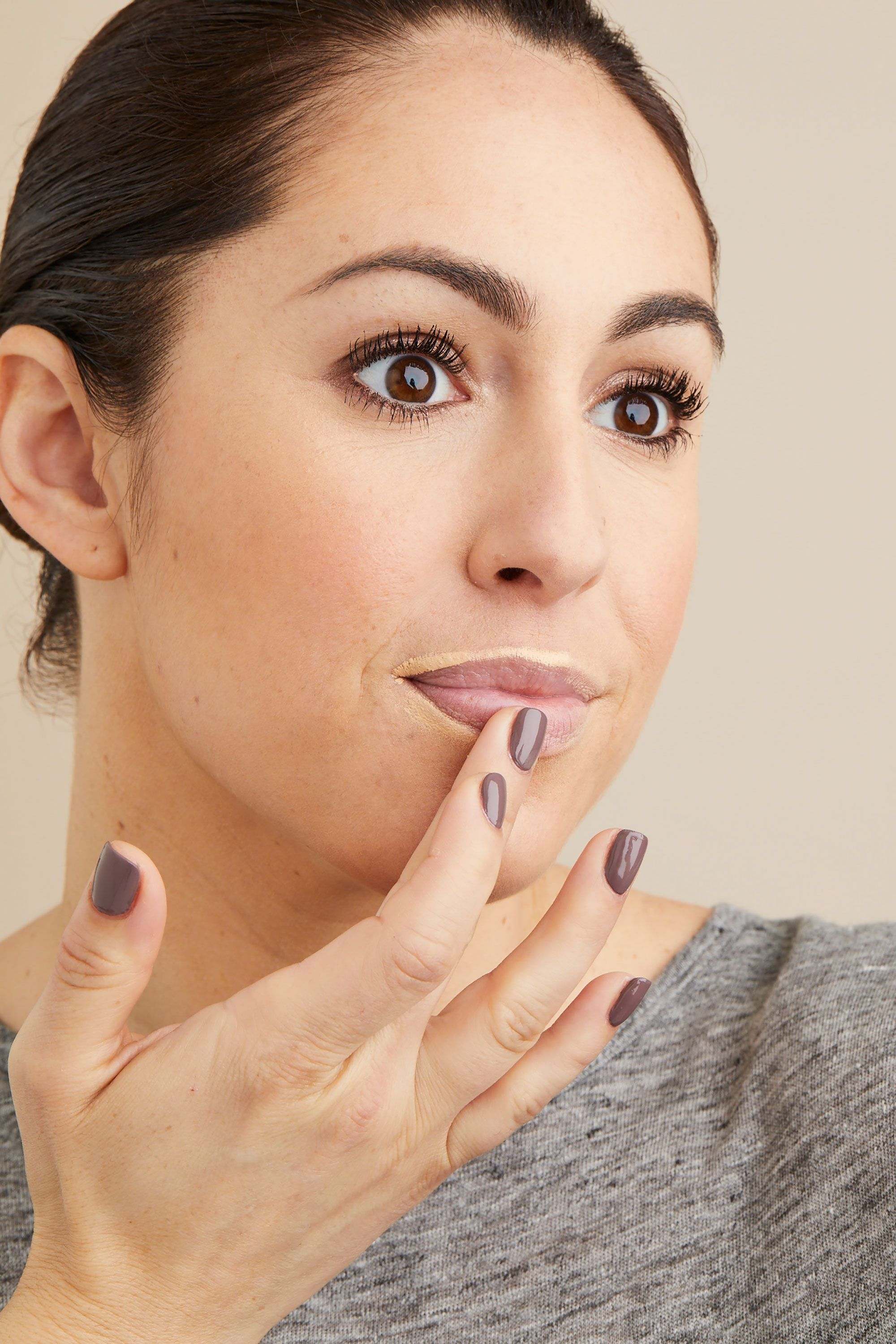 """<p>To keep your lipstick from bleeding, trace your regular concealer around the outer edge of your mouth, then press it into the skin with your finger to blend.<span class=""""redactor-invisible-space"""" data-verified=""""redactor"""" data-redactor-tag=""""span"""" data-redactor-class=""""redactor-invisible-space""""></span></p>"""