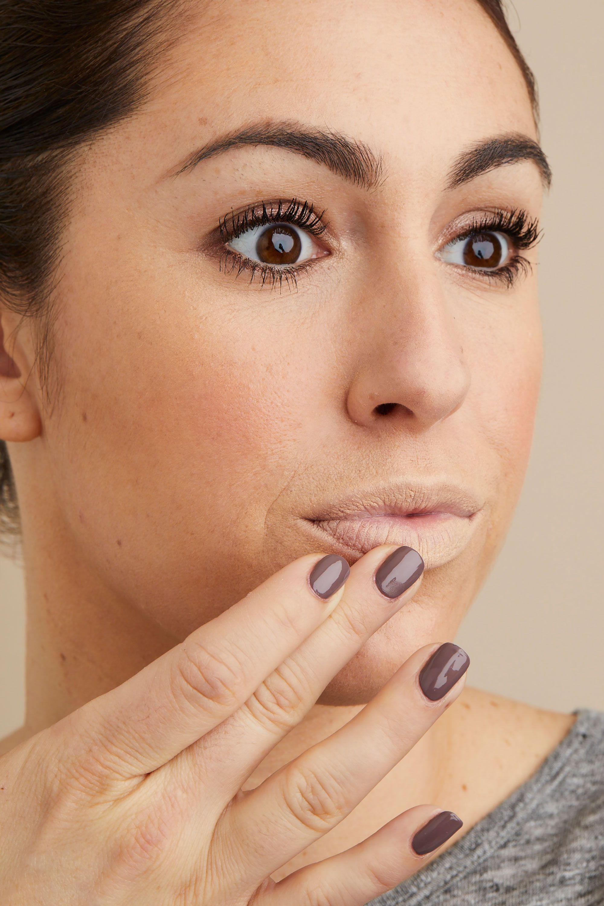 """<p>Next, tap a thin layer of the concealer over your entire mouth. (If your lips are dry, dab on a bit of waxy balm first and wait a minute for it to be absorbed.) This helps your lipstick adhere so it won't fade or run.<span class=""""redactor-invisible-space"""" data-verified=""""redactor"""" data-redactor-tag=""""span"""" data-redactor-class=""""redactor-invisible-space""""></span></p><p><strong data-verified=""""redactor"""" data-redactor-tag=""""strong"""">RELATED:<a href=""""http://www.redbookmag.com/beauty/makeup-skincare/g3332/best-lipstick-shades-for-every-skin-tone/"""" target=""""_blank"""" data-tracking-id=""""recirc-text-link"""">The Perfect Lipstick Shades for Every Skin Tone</a><span class=""""redactor-invisible-space""""><a href=""""http://www.redbookmag.com/beauty/makeup-skincare/g3332/best-lipstick-shades-for-every-skin-tone/""""></a></span></strong><br></p>"""