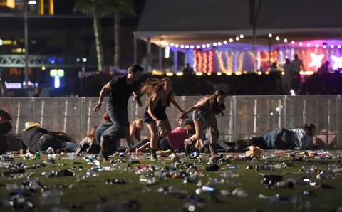 <p>People seek cover after the gunman opened fire. </p>