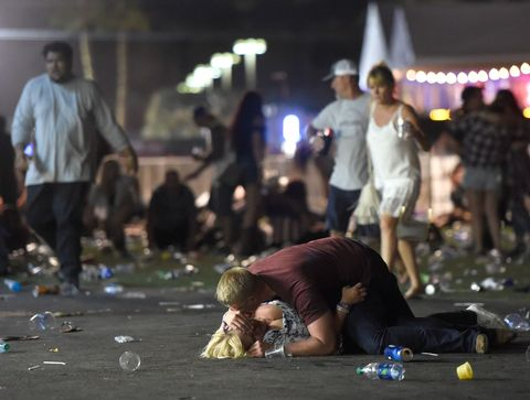 <p>A man and woman lie on the ground in the aftermath of the shooting. </p>