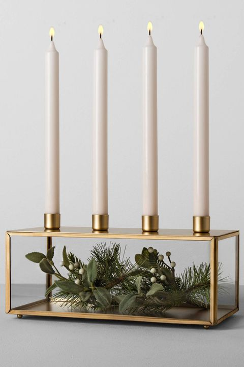 "<p>$23</p><p><a href=""https://www.target.com/p/glass-and-metal-taper-candle-holder-brass-hearth-hand-153-with-magnolia/-/A-52576148"" target=""_blank"" class=""slide-buy--button"" data-tracking-id=""recirc-text-link"">BUY SOON</a></p><p>Display your tapers and seasonal decor in this one-of-a-kind piece, which you can style on your dining table, mantel, or entryway console. </p>"