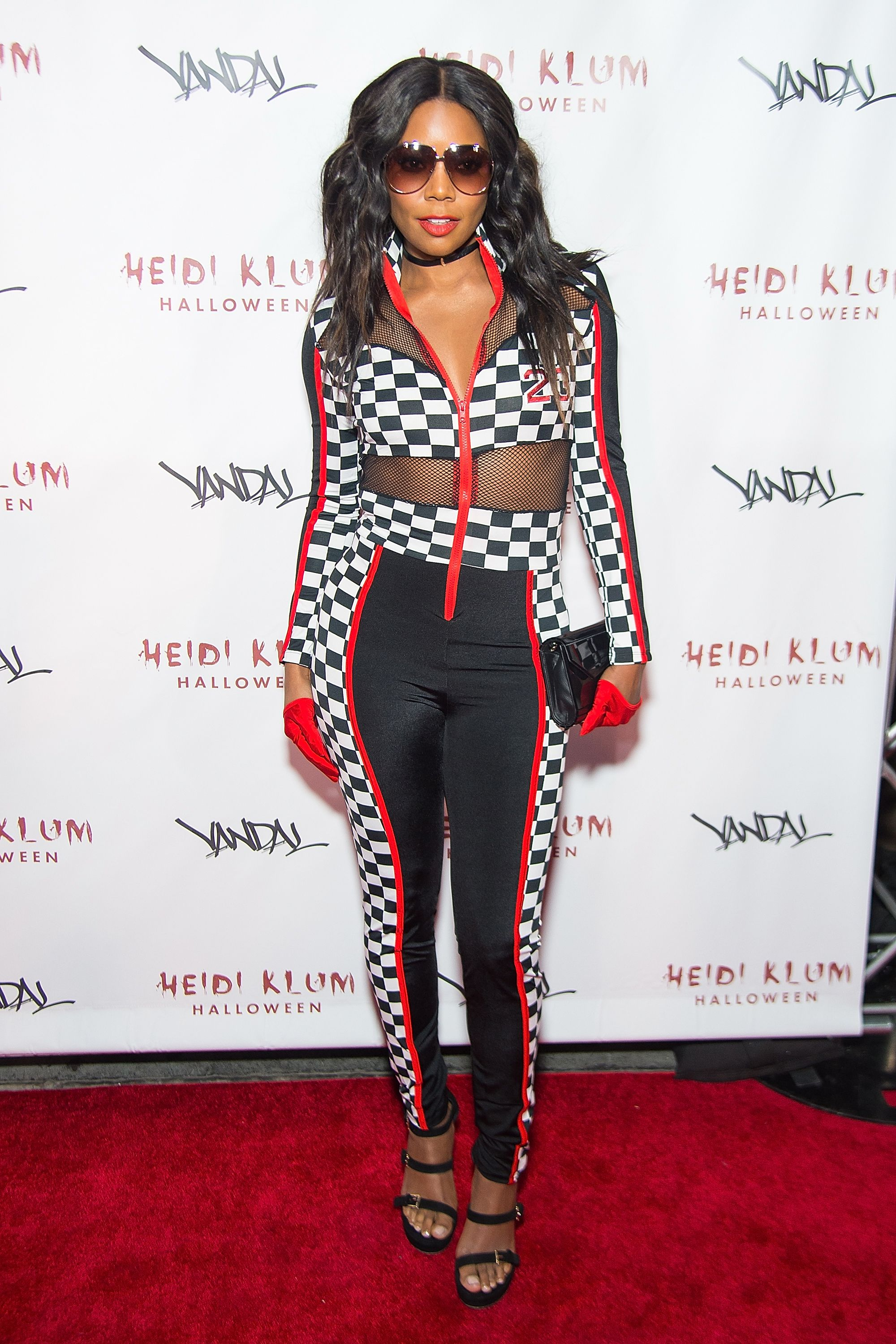 <p>Actress Gabrielle Union dressed up the race car driver look with some heels and sassy sunglasses for her Halloween evening in 2016.</p>