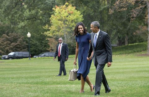"""<p>Michelle and Barack Obama smile at each other and walk hand-in-hand on the White House Lawn from Marine One, a Marine Corps aircraft. Throughout <em data-redactor-tag=""""em"""">Chasing Light</em>, Lucidon captures many moments of affection between the loving spouses.</p>"""