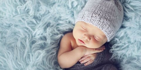Textile, Comfort, Baby sleeping, Wool, Child, Baby & toddler clothing, Headgear, Costume accessory, Knitting, Bonnet,