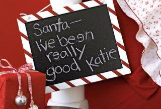 blackboard with a santa note