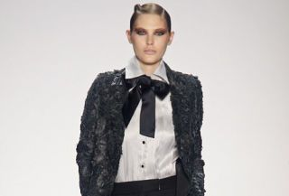 model on bill blass runway wearing lace and bows on shirt