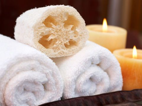loofah and towels with candles
