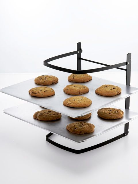 baker's rack holding chocolate chip cookies