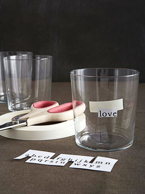 drinking glass with photocopied words and scissors and tape