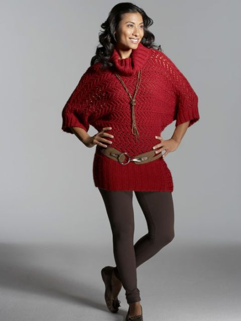woman in red sweater wearing low slung belt with leggings and flats