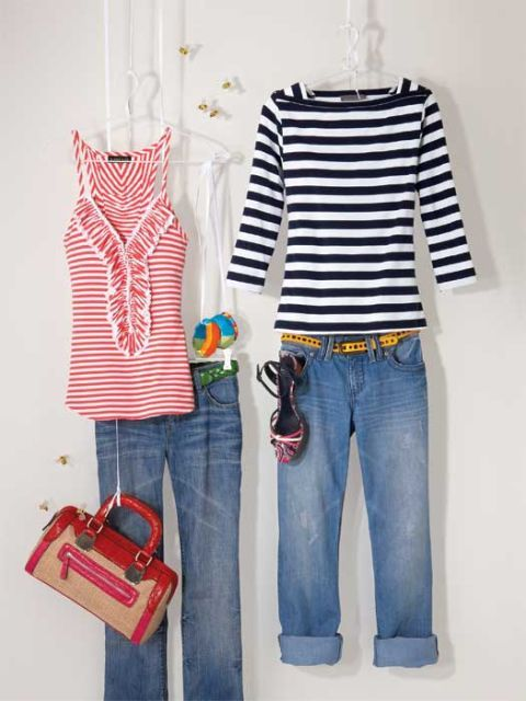 jeans and striped shirts on hangers and strings