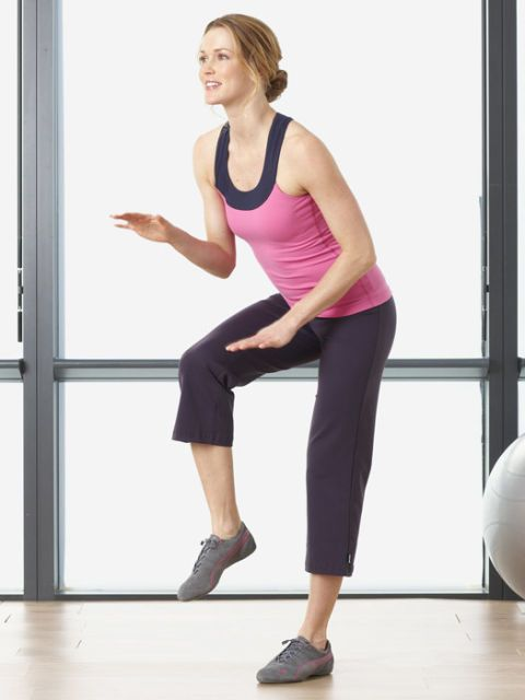 woman in workout gear doing bollywood dance move