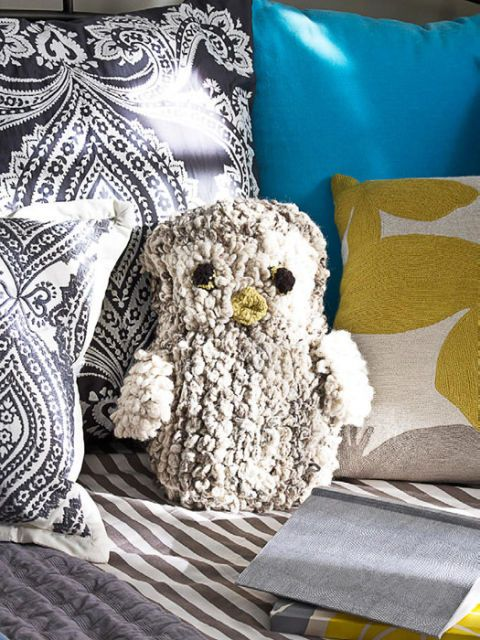 stuffed owl on bed
