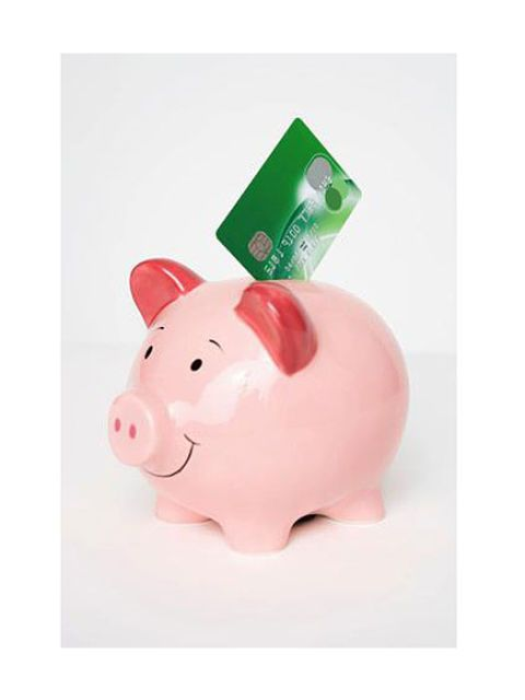 piggy bank with credit card in it