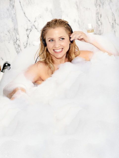 actress jessica capshaw in a bubble bath with headphones on