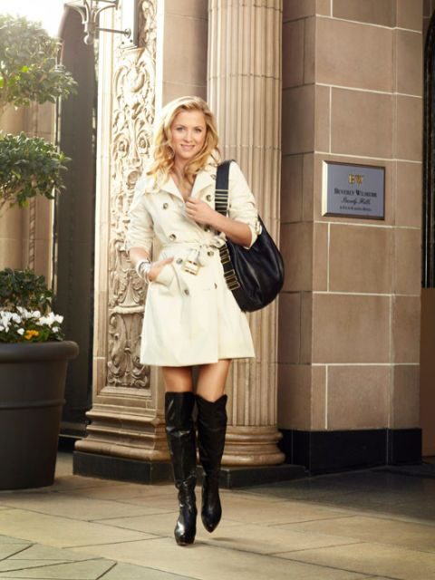 jessica capshaw in boots and a trench coat