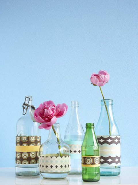 decorative glass bottles with flowers in them