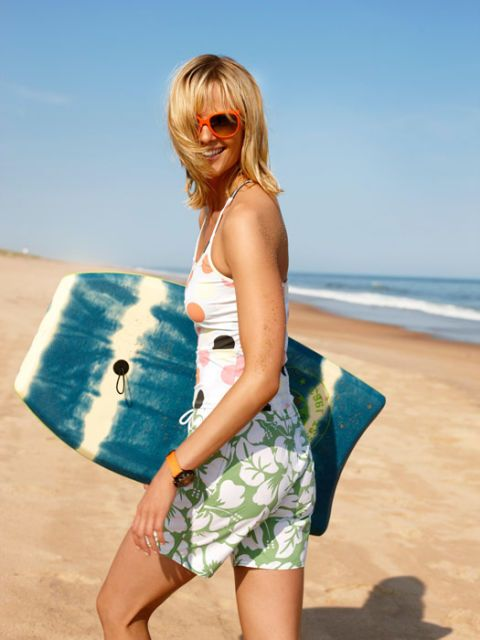 woman at the beach with boogie board