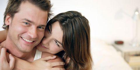woman embracing husband