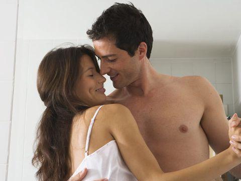 couple dancing in the bedroom