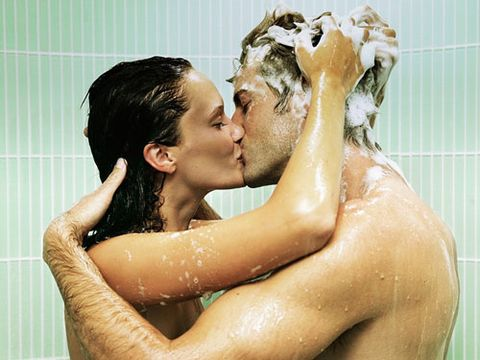 man and woman soapy and kissing in the shower