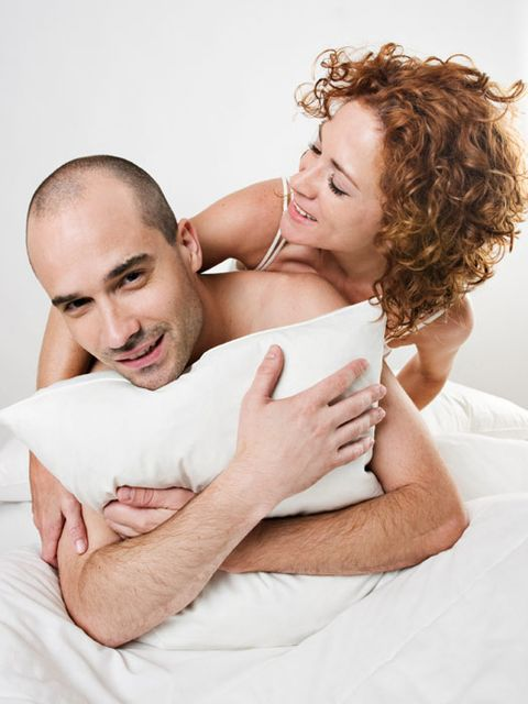 man and woman lying down smiling
