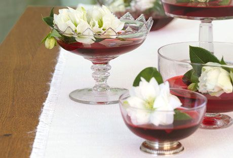 flowers in bowls with red water