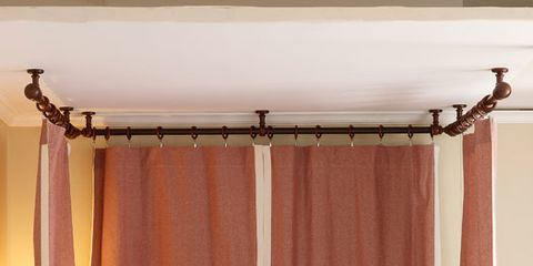 full shot of a bed surrounded by panel curtains