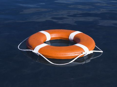 orange life saver in blue water