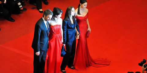celebrities on red carpet in front of photographers