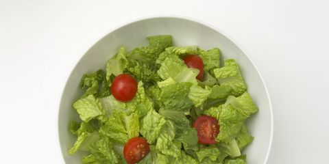 green salad in bowl with cherry tomatoes