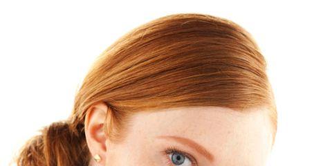 redheaded woman wearing orange lipstick