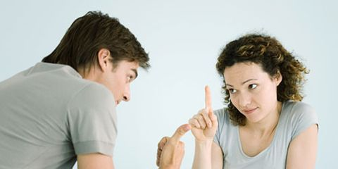 man and woman having a discussion and making gestures