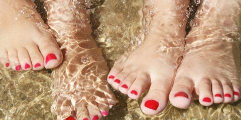 pedicured feet in water