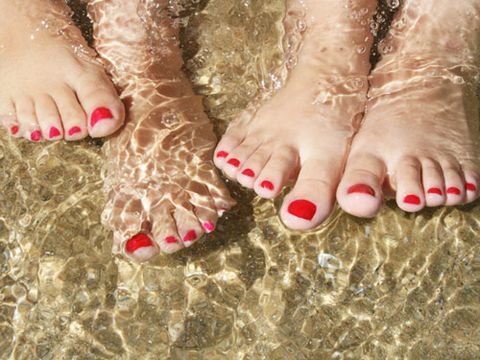 pedicured feet in water