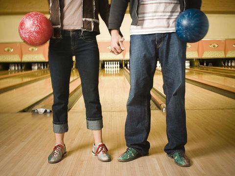 man and woman bowling