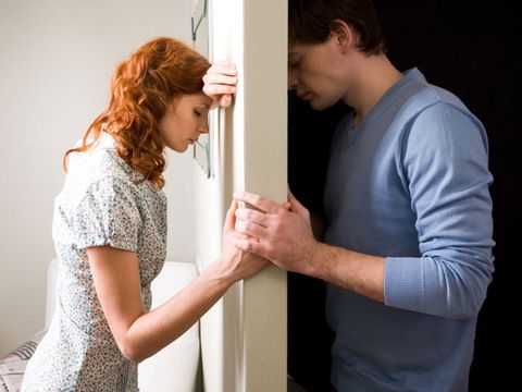 man and woman with secrets holding hands in separate rooms