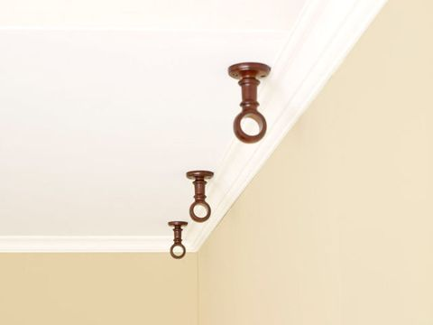 curtain brackets mounted on ceiling