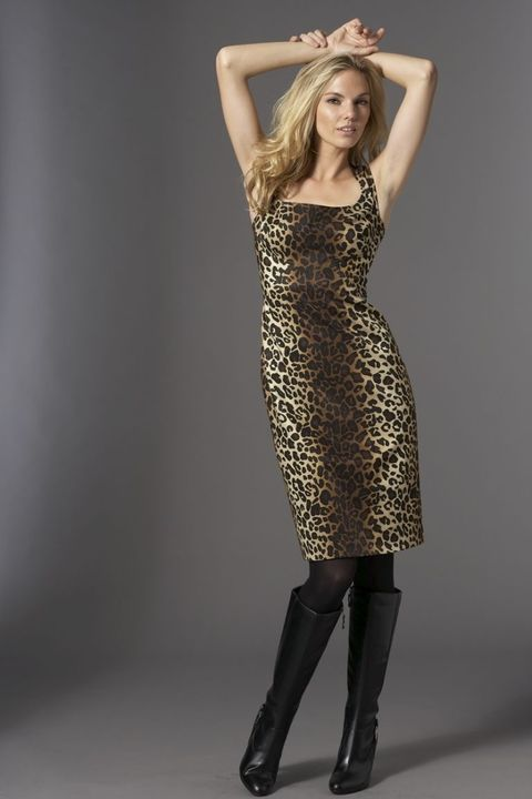 <b>A sophisticated dress that hits just above the knee is a chic topper for tall black boots.</b>