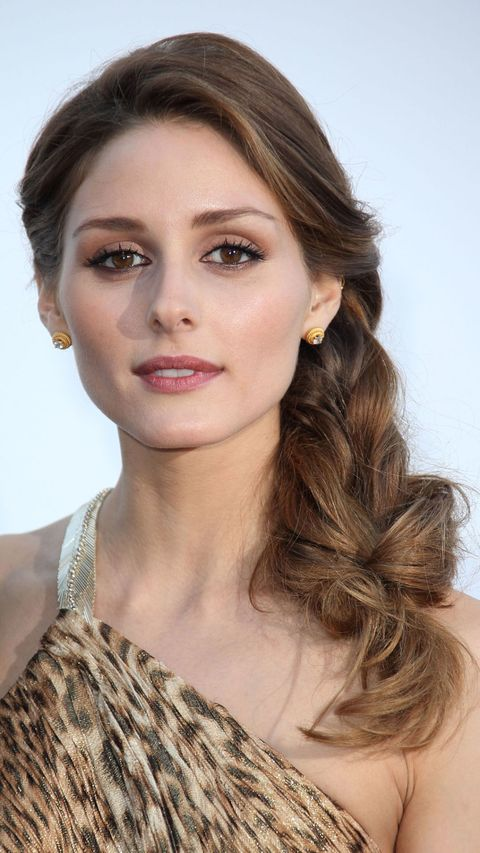 Olivia Palermo with hair in a loose side braid