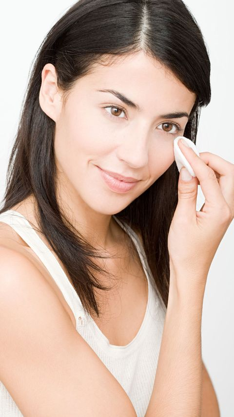 woman applying serum to face