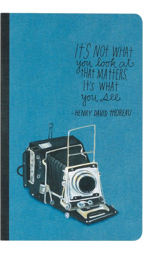 blue notebook with camera and quote
