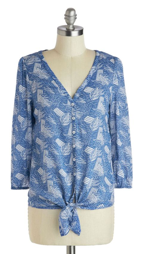 blue patterned blouse with knot at the bottom